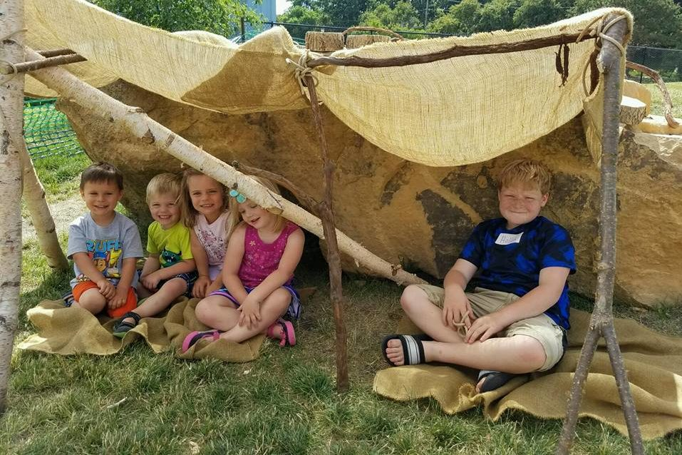 Fort building in the Dotson Back 40 nature play area at the Childrens Museum of Southern Minnesota Mankato