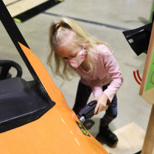 Charging electric vehicle in the Energy: Powered by Play exhibit